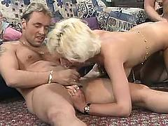 Blonde slut in orgy